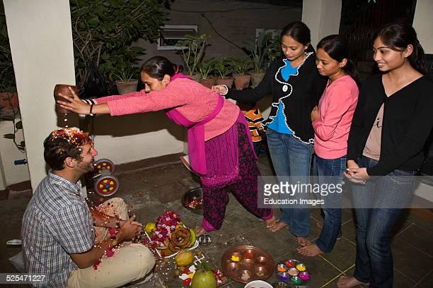 Man Receives Bai Tika Or Brother Puja From His Newari Sisters During The Annual Celebration Of Tihar Kathamandu Nepal
