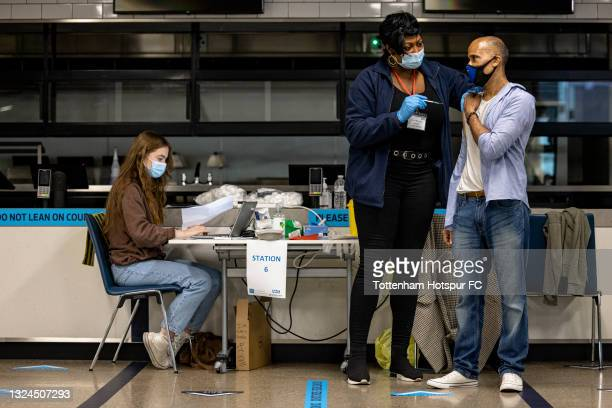 Man receives the Covid-19 vaccine at a walk-in vaccination clinic taking place at the Tottenham Hotspur Stadium on June 20, 2021 in London, England.