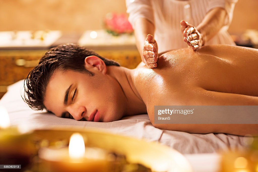 Man receiving back massage. : Stock Photo