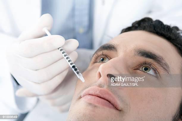 Man receiving Botox injection