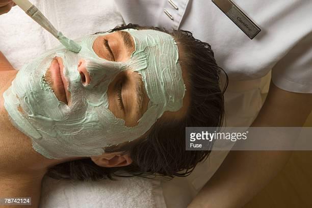Man Receiving Facial Treatment
