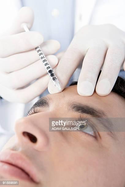 Man receiving neurotoxin injection
