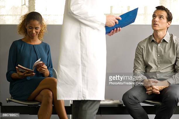 Man receiving news from doctor in waiting room