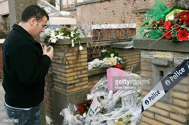 A man recites from the Koran at the entrance of the house of the Mokadem family at the General Jaques Avenue March 2 2007 in Nivelles Belgium The...