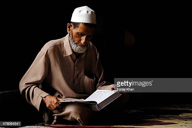 CONTENT] A man recites holy Quran in Jamia masjid in Nowhatta old city Srinagar