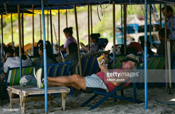 Man reclines at a restaurant on a beach on May 24, 2020 in Hua Hin, Thailand. As the province of Prachuap Khiri Khan signed orders to re-open hotels...