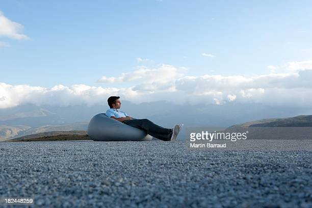 Man reclining on a comfy chair outdoors
