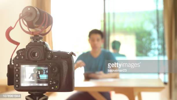 man recording video for diy stuff preparation - vlogging stock pictures, royalty-free photos & images