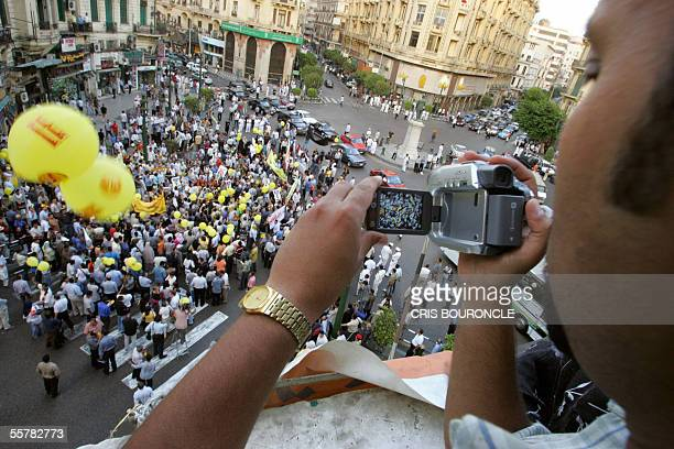 A man records a protest against Egyptian President Hosni Mubarak in a central square in downtown Cairo 27 September 2005 organized by the leftwing...