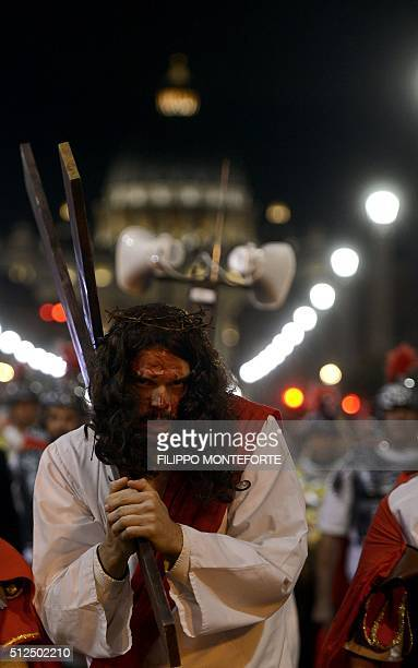 Man reenacts the way of the cross by Jesus Christ on Via della Conciliazione leading from St.Peter's Basilica at the Vaticano in Rome on February 26,...
