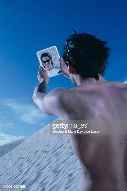 Man Reflected in Hand Mirror