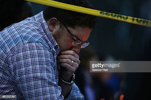 A man reflects during a candlelight vigil attended by hundreds at Jonathan Law High School after the death of Maren Sanchez who was stabbed to death...