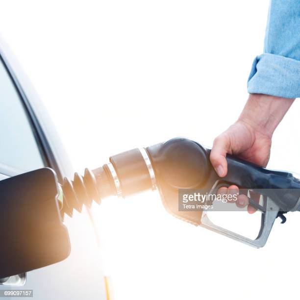 Man refueling car