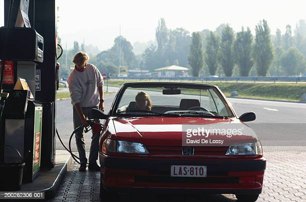 Man refuelling gas tank