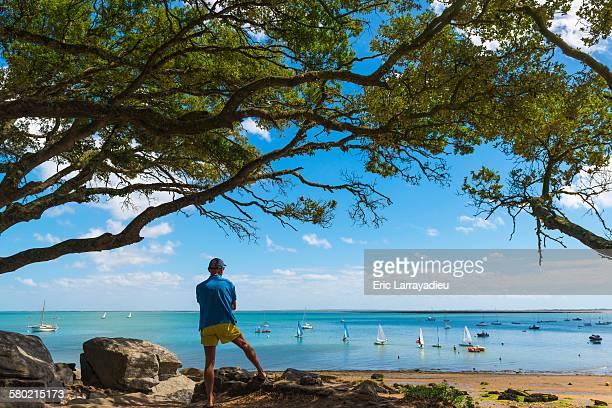 Man regarding the sea , plage des Sableaux