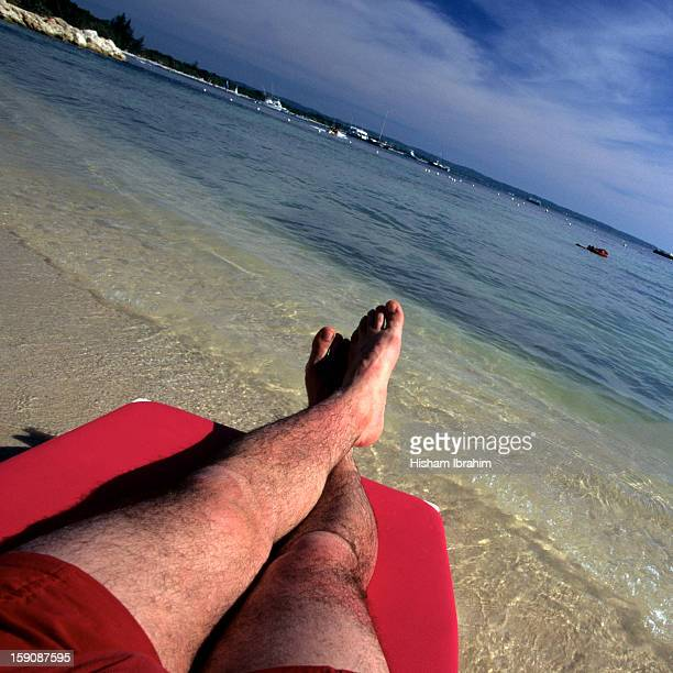 Man relaxed on lounge chair on a beach, Jamaica