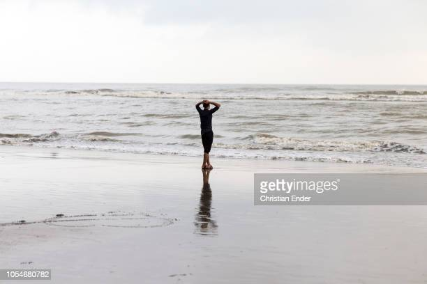 Cox´s Bazar Bangladesh October 14 2018 A man relaxes at the beach during the sunset The beach of Cox's Bazar wIth 120 km long sandy beach it is a...