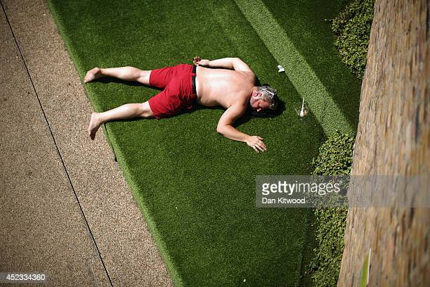 A man relaxes in an area next to the Canal at King's Cross on July 18 2014 in London England The Met Office has issued a heatwave alert as...