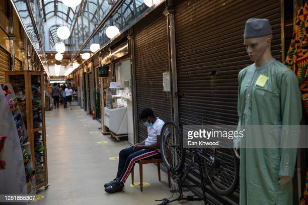 A man relaxes in an empty arcade in Brixton on June 24 2020 in London England Yesterday the Prime Minister Boris Johnson announced the reopening of...