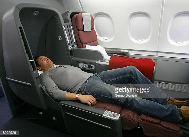 A man relaxes in the new business class seat onboard the new Qantas A380 flagship the 'NancyBird Walton' as she joins the Qantas fleet at Sydney...