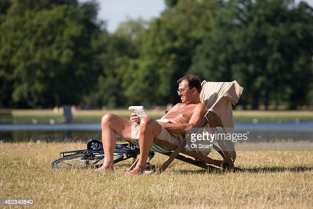 A man relaxes in the warm weather in Hyde Park on July 18 2014 in London England The Met Office has issued a heatwave alert as temperatures soar to...
