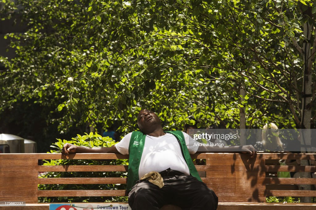 A man relaxes on a bench near Times Square on July 16, 2013 in New York City. A stifling heat wave has descended upon the New York City region for the week; temperatures are expected to reach into the 100s.