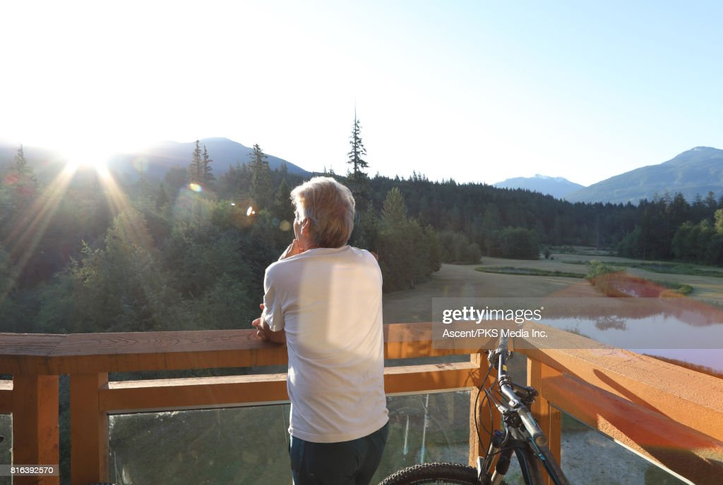 Man Relaxes On Veranda Looks Out To Mountains High-Res Stock Photo - Getty Images