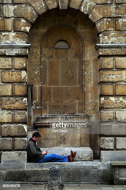 A man relaxes outside Radcliffe Camera on September 20 2016 in Oxford England Oxford University has taken number one position in the 20162017 world...