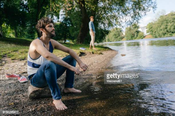 man relaxing at the water - barefoot black men stock pictures, royalty-free photos & images