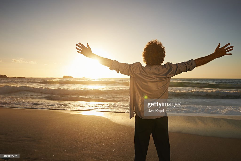 Man relaxing by the sea : Stock Photo