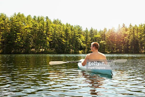 man relaxing in a kayak. - lake solitude (new hampshire) stock photos and pictures