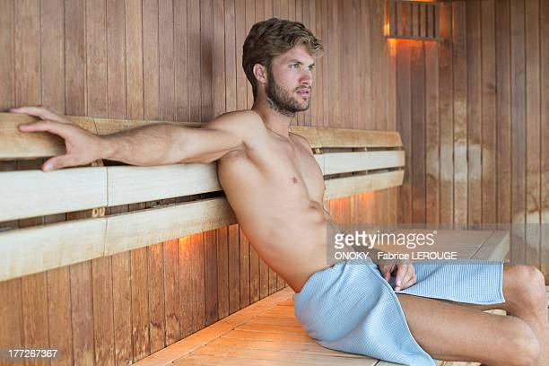 man relaxing in a sauna - mid adult stock pictures, royalty-free photos & images