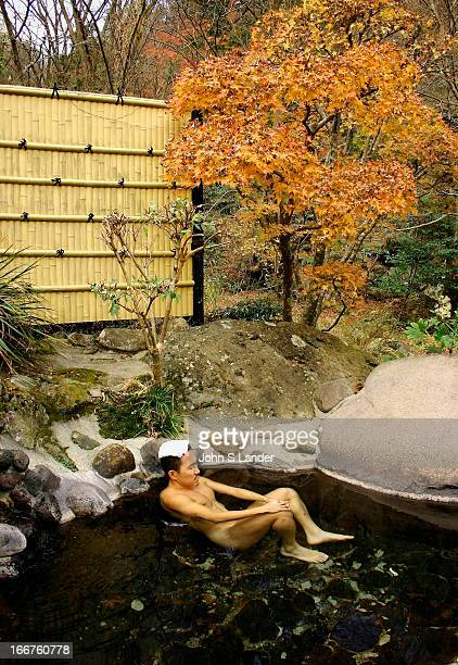 A man relaxing in an openair hot spring in the village of Miyanoshita in Hakone National Park Openair baths called 'rotemburo' are popular in every...