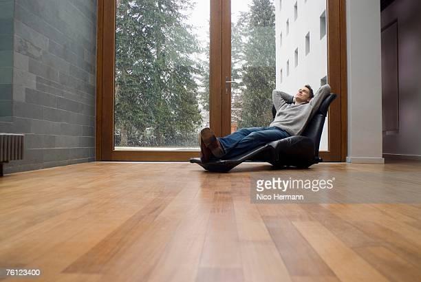 Man relaxing in armchair