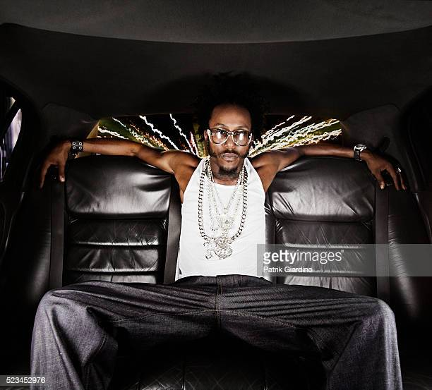 man relaxing in backseat of limo - bling bling stock pictures, royalty-free photos & images
