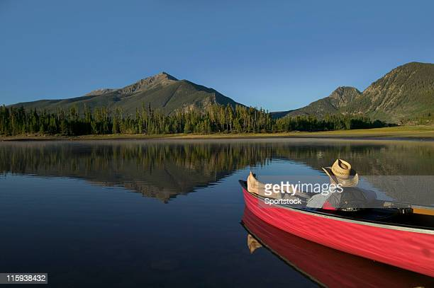 man relaxing in canoe with mountain view - arkansas stock photos and pictures