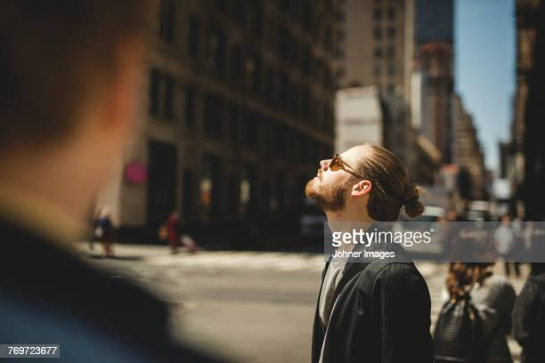 Man relaxing in city