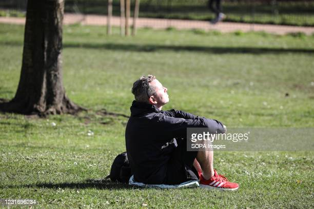 Man relaxing in St James' Park.