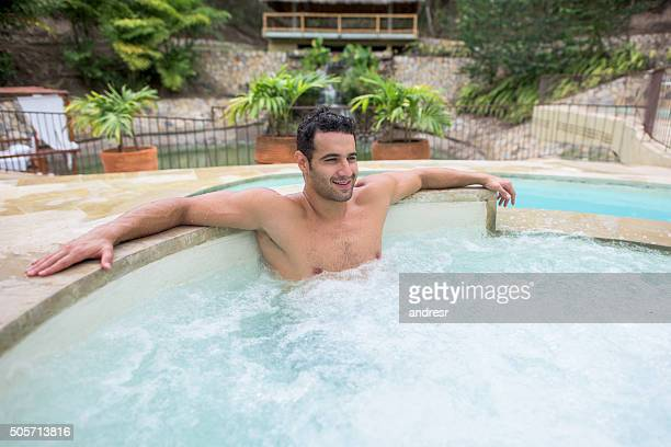man relaxing in the hot tub - hot tub stock photos and pictures