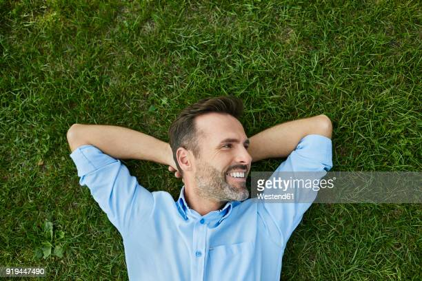 Man relaxing on a meadow, top view