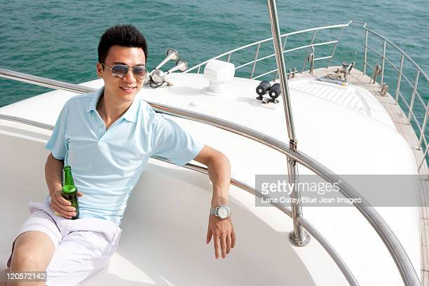 Man Relaxing on a Yacht