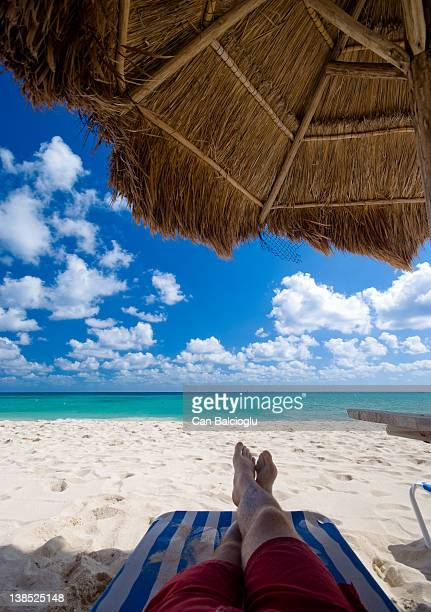 man relaxing on beach chair - legs crossed at ankle stock pictures, royalty-free photos & images