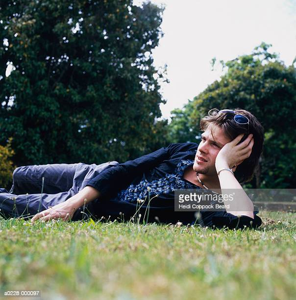 man relaxing on grass - heidi coppock beard stock pictures, royalty-free photos & images