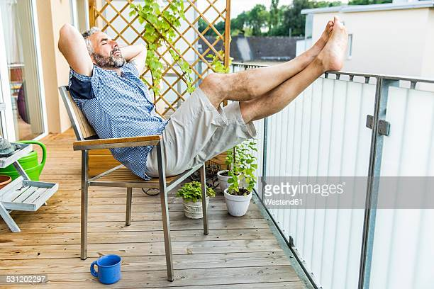 Man relaxing on his balcony