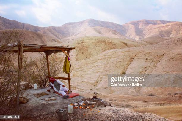 man relaxing on landscape against mountains - west bank stock pictures, royalty-free photos & images