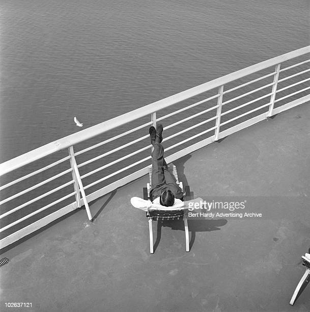 A man relaxing on the deck of a United States Lines passenger ship Southampton 10th August 1960