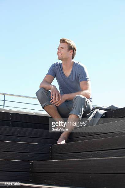 Man relaxing on wooden steps