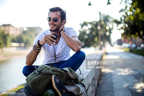 man relaxing outdoors - tee sports equipment stock photos and pictures