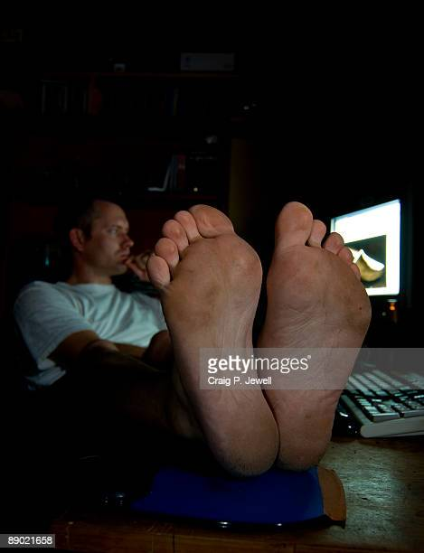 Man Relaxing with Feet on Desk