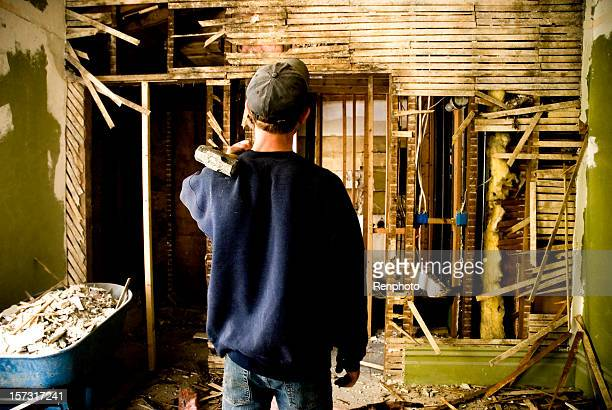 man remodeling a home - rebuilding stock pictures, royalty-free photos & images